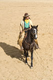 Cowboy riding into town. On his horse at Mini Hollywood Spain Royalty Free Stock Image