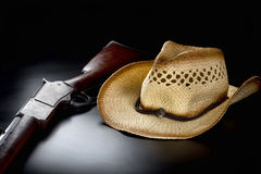 Cowboy Rifle and Hat. Stock Images