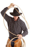 Cowboy with rope over head Stock Photo