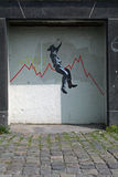 Cowboy on a rough stock market ride. Cowboy with hat rodeo riding a humpy stock exchange graph - street art grafitti Royalty Free Stock Image