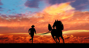 Cowboy and running horse Stock Photos