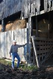 Cowboy By a Rustic Barn 2 Stock Photography