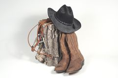 Cowboy's Nightstand. Cowboy hat, boots and reins Royalty Free Stock Images