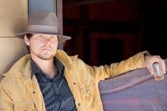 Cowboy am Saal Stockbilder