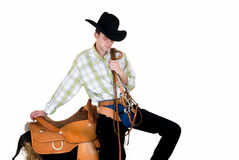 Cowboy with saddle and rein Royalty Free Stock Photos