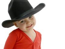 Cowboy-Schätzchen mit schwarzem Hut lizenzfreies stockfoto