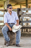 Cowboy seated Royalty Free Stock Photography