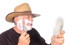 Cowboy shaving Royalty Free Stock Photo