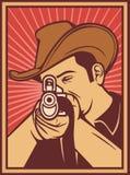 Cowboy shooting a rifle. Cowboy pointing his rifle, cowboy aiming his rifle Royalty Free Stock Images