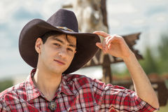 Cowboy on sign background. Stock Photos