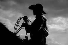 Cowboy Sihouette. Steer roper cowboy black and white backlight silhouette photo Royalty Free Stock Images