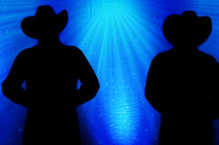 Cowboy Silhouette, fond bleu images stock