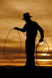 Cowboy silhouette hold rope loop Stock Photos