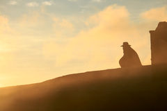 Cowboy silhouetted against the sunrise Royalty Free Stock Photo