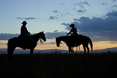 Cowboy silhouettes Stock Images