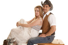 Cowboy sit woman in front looking Royalty Free Stock Photo