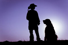 Cowboy & Sitting Dog Silhouette Royalty Free Stock Image