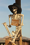 A Cowboy Skeleton Sits Against a Post Stock Image