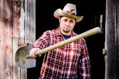 Cowboy Smirking und Übergebungs-Schaufel zu Ihnen Lizenzfreie Stockbilder
