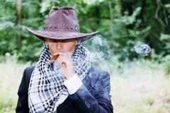 Cowboy smokes Stock Image