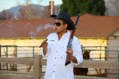 Cowboy smoking a cigar and relaxing Stock Photos