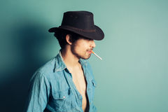 Cowboy smoking a cigarette Stock Photo
