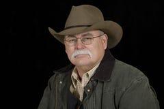 cowboy som ser stoisk Arkivbild
