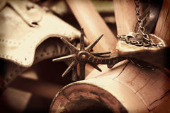 Cowboy Spur on Wagon Wheel Stock Image