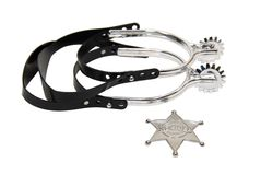 Cowboy spurs and star. Cowboy spurs and sheriff star in silver and leather - path included royalty free stock images