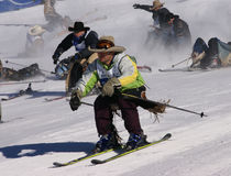 Cowboy Stampede - mass start of skiing cowboys Royalty Free Stock Image