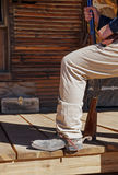 Cowboy steps onto the porch Stock Image