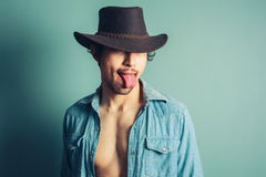 Cowboy sticking his tongue out Stock Photos