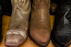 Cowboy Store. Mens cowboy boots on shelf royalty free stock images