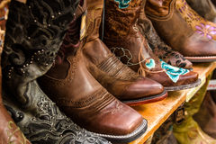 Cowboy Store. Colorful display of womens cowboy boots stock photos