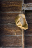 Cowboy straw hat against weathered wood Stock Photography
