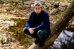 Cowboy at Stream looking at You Royalty Free Stock Images