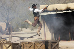 A Cowboy Stuntman Performs at Old Tucson. Tucson, Arizona - March 9: Old Tucson on March 9, 2015, in Tucson, Arizona. An Old Tucson stuntman, Austin D. Buchanan Stock Photography