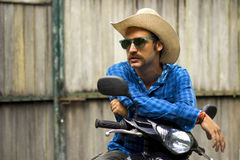 Cowboy sulla motocicletta Immagine Stock