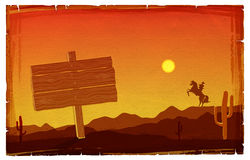 Cowboy at sunset. Vector texas background with board for design Stock Photos