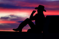 Cowboy Sunset. Cowboy sitting on his pickup truck watching the sunset Royalty Free Stock Photos