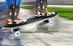 Cowboy Riding Surfer. Cowboy surfer on a street skateboard royalty free stock photo