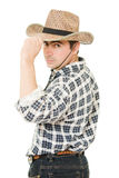 Cowboy takes off his hat. Royalty Free Stock Image