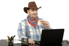 Cowboy talking with friends on Skype Stock Photos