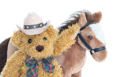 Cowboy Teddy bear and horses Stock Image