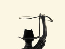 Cowboy throws a lasso b/w. Cowboy throws a lasso on the isolated background Royalty Free Stock Photography