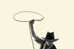 Cowboy throws a lasso. On the isolated background Stock Images