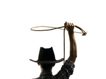 Cowboy throws a lasso. On the isolated background Royalty Free Stock Image