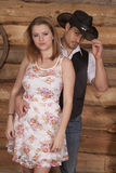 Cowboy touch hat holding woman Royalty Free Stock Photo