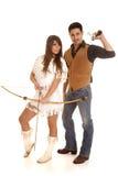 Cowboy und indischer Frauengewehrrückseitenbogen Stockbilder