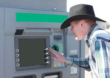 Cowboy Using ATM Machine Royalty Free Stock Photo